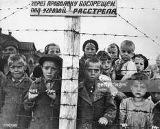 World war 2, children behind barbed wire in a german concetration camp set up in the occupied part of the karelian assr, 1941 or 1942. (Photo by: Sovfoto/Universal Images Group via Getty Images)